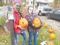 A family picks a pumpkin along the Savour Stratford Pumpkin Trail.