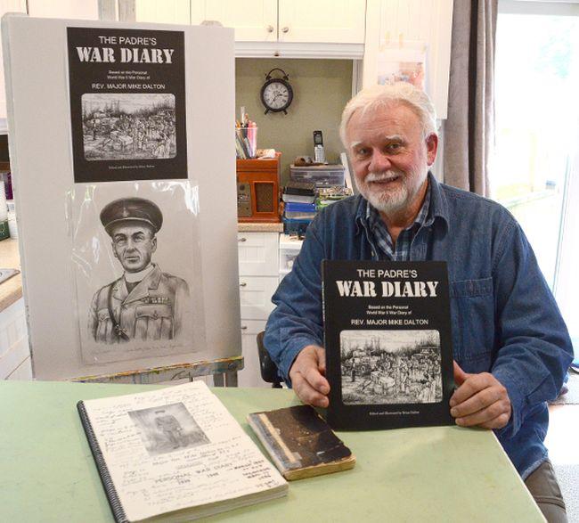 Brian Dalton holds a copy of his book. (Rob Gowan The Sun Times)