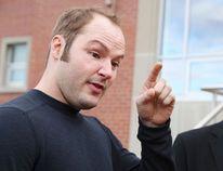 Justin Stewart addresses the media outside the Sudbury Courthouse on Monday. (Gino Donato/Sudbury Star)