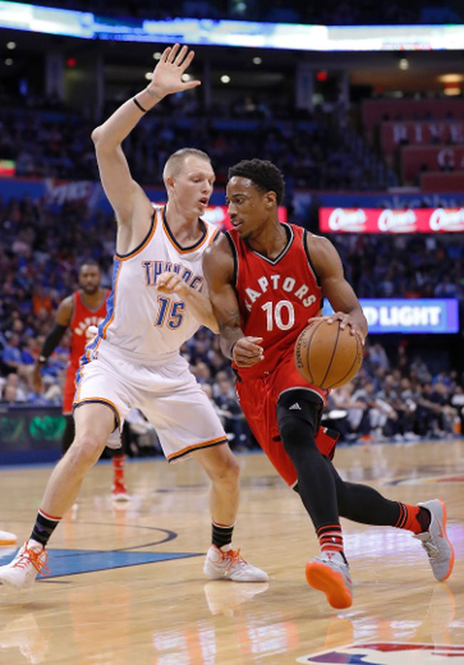 Thunder forward Kyle Singler (15) defends as Raptors guard DeMar DeRozan (10) drives to the basket during first half NBA action in Oklahoma City on Wednesday, Nov. 9, 2016. (Alonzo Adams/AP Photo)