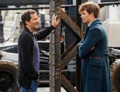 "David Heyman and Eddie Redmayne on the set of ""'Fantastic Beasts."""
