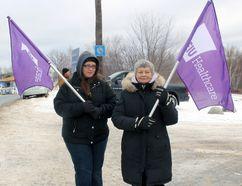 Sarah King, left, and Caroline Commanda walk the picket line at the St. Joseph Motherhouse, Tuesday morning. PJ Wilson/The Nugget