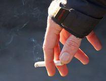 A man holds a smoking cigarette near Belleville city hall on Friday December 11, 2015 in Belleville, Ont. Tim Miller/Belleville Intelligencer/Postmedia Network
