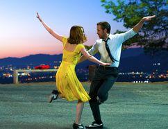 Emma Stone and Ryan Gosling dance in a scene from La La Land. (Handout Photo)