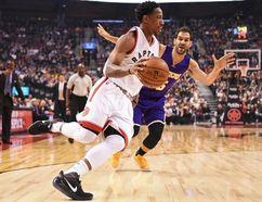 Raptors guard DeMar DeRozan (10) drives past Lakers guard Jose Calderon (5) during first half NBA action in Toronto on Friday, Dec. 2, 2016. (Frank Gunn/The Canadian Press)