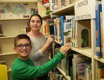 R.L. Beattie Public School students Max Arnold, front, and Amanda Bourdon spend time in the school library on Thursday. (John Lappa/Sudbury Star)