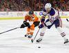 Leon Draisaitl #29 of the Edmonton Oilers moves the puck in front of Brayden Schenn #10 of the Philadelphia Flyers before scoring a first period goal at Wells Fargo Center on December 8, 2016 in Philadelphia, Pennsylvania.