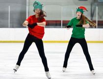 Sydney Perron (red) and Svea Goodman perform at the Cochrane Skating Club's Carnival, Dec. 15.