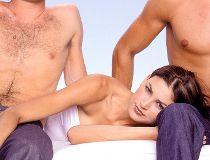 Woman lying across two guys' laps