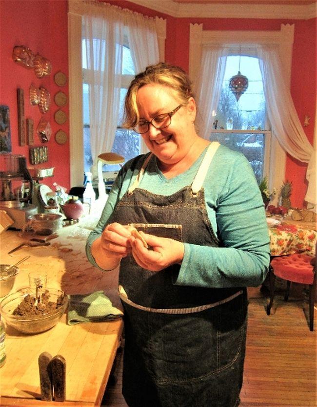 Carolyn Rundle in her colourful kitchen making mushroom vushka (dumplings). (Supplied photo)