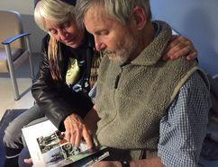 Ed and Mary Farrar look over an album of family photos in Kingston, Ont. Paul Schliesmann Kingston Whig-Standard