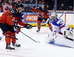 Canada forward Tyson Jost makes a move on Russia goaltender Ilya Samsonov and scores a goal during the world junior hockey championship in Toronto on Dec. 26, 2016. (Dave Abel/Toronto Sun)