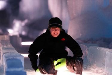 Jayden Somer from Red Deer rides a Crazy Carpet down the ice slide at Ice Castles at Hawrelak Park in Edmonton, Alberta on Friday, December 30, 2016. Ian Kucerak / Postmedia