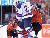 U.S. forward Kieffer Bellows (23) hits Canada forward Mathieu Joseph (11) during first period world junior hockey championship action in Toronto on Saturday, Dec. 31, 2016. (Nathan Denette/The Canadian Press)