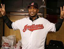 New Cleveland Indian Edwin Encarnacion smiles wearing an Indians baseball jersey on Jan. 5, 2017. (AP Photo/Tony Dejak)