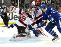 Maple Leafs' Auston Matthews (rear) scores a goal behind Devils goaltender Cory Schneider as Leafs' Zach Hyman (right) looks on during first period NHL action in Newark, N.J., on Friday, Jan. 6, 2017. (Bill Kostroun/AP Photo)