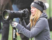 Photographer Johany Jutras surveys the action on the field while she shoots an Ottawa Redblacks game for her book. (Chris Hofley photo)