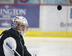 Sudbury Wolves goalie Jake McGrath wears his new helmet during team practice in Sudbury, Ont. on Thursday December 1, 2016. Gino Donato/Sudbury Star/Postmedia Network