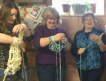Bervie Women's Institute members Katie and Ellen Waye, Sandra MacDonald, Diane Wilson and Sylvia Hasbury gave armknitting a try during the Jan. 11, 2017 meeting.