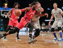 Raptors forward DeMarre Carroll (5) drives against Nets forward Joe Harris (12) during first quarter NBA action in New York on Tuesday, Jan. 17, 2017. (Julie Jacobson/AP Photo)
