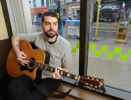 Singer Ian Raeburn performs Thursday night at the Cardboard Cafe, 114 Dundas St. His song Georgian Bay became a CBC Radio hit. (MORRIS LAMONT, The London Free Press)