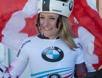 Mirela Rahneva, of Ottawa, celebrates her victory at a women's skeleton World Cup race in St. Moritz, Switzerland, on Friday, Jan. 20, 2017. (Urs Flueeler/Keystone via AP)