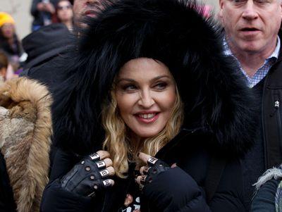 Madonna smiles before she performs during the Women's March on Washington, Saturday, Jan. 21, 2017 in Washington. (AP Photo/Jose Luis Magana)