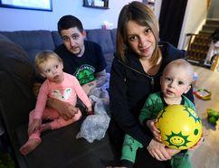 Ed Balsdon holds daughter Rylee and Andrea Gangel holds son Steven in Oshawa on Wednesday, January 18, 2017. (Dave Abel/Toronto Sun)