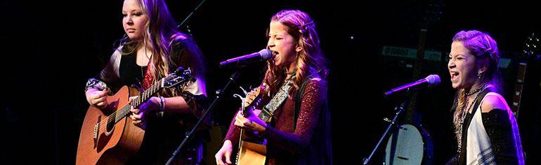 Cassie, Haley and Hannah Van Maele from Small Town Girls perform Friday night in Barrie. (CHRIS ABBOTT/TILLSONBURG NEWS)