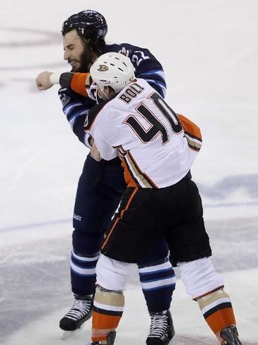 Anaheim Ducks' Jared Boll (40) and Winnipeg Jets' Chris Thorburn (22) fight during first period NHL hockey action in Winnipeg, Monday, January 23, 2017. THE CANADIAN PRESS/Trevor Hagan