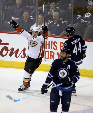 Anaheim Ducks' Rickard Rakell (67) celebrates after scoring as Winnipeg Jets' Dustin Byfuglien (33) and Josh Morrissey (44) look on during first period NHL hockey action in Winnipeg, Monday, January 23, 2017. THE CANADIAN PRESS/Trevor Hagan