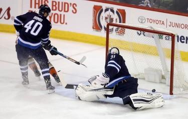 Anaheim Ducks' Logan Shaw (48) scores on Winnipeg Jets goaltender Ondrej Pavelec (31) as Jets' Joel Armia (40) defends during first period NHL hockey action in Winnipeg, Monday, January 23, 2017. THE CANADIAN PRESS/Trevor Hagan