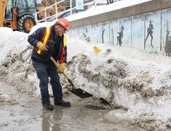 City crews clear snow and ice from catch basins around Greater Sudbury. (John Lappa/Sudbury Star file photo)