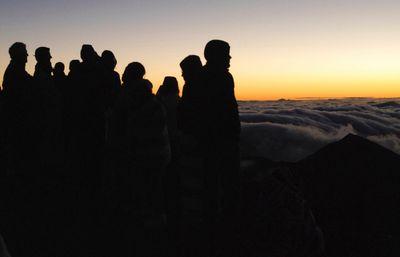 "People gather ahead of the sunrise on the summit of Haleakala volcano in Haleakala National Park on Hawaii's island of Maui, Sunday, Jan. 22, 2017. Mark Twain called the daily phenomenon the ""sublimest spectacle"" he ever witnessed. (AP Photo/Caleb Jones)"