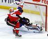 Senators' Zack Smith scores on New York Islanders goalie Thomas Greiss during Saturday's game. (THE CANADIAN PRESS)