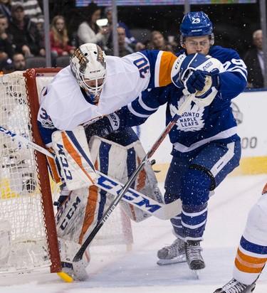 Toronto Maple Leafs center William Nylander (29) looks like he is giving  New York Islanders goalie Jean-Francois Berube (30) a shot to the stomach   in Toronto on Tuesday February 14, 2017. Craig Robertson/Toronto Sun/Postmedia Network