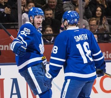 Toronto Maple Leafs left wing Josh Leivo (32) celebrates his goal with Toronto Maple Leafs right wing Ben Smith (18)  in Toronto on Tuesday February 14, 2017. Craig Robertson/Toronto Sun/Postmedia Network