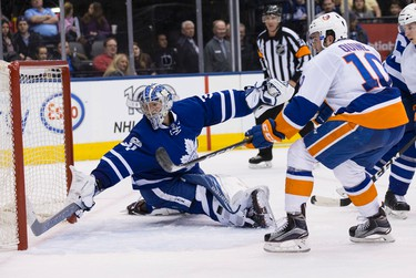 Toronto Maple Leafs goalie Frederik Andersen (31) stops New York Islanders center Alan Quine (10)   in Toronto on Tuesday February 14, 2017. Craig Robertson/Toronto Sun/Postmedia Network