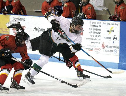Gemini's Brandon Odorjan tries to dodge a Dorchester hip check Monday during a TVRA East playoff hockey game in Tillsonburg. Glendale swept the best of three quarter final series 2-0 with back to back 8-1 wins. (CHRIS ABBOTT/TILLSONBURG NEWS)