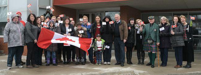 Waving the flag on Flag Day at the Livingson Centre. (CHRIS ABBOTT/TILLSONBURG NEWS)