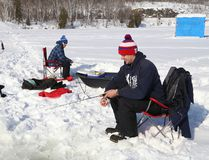 Chad Brousseau, left, and Tyler Gliebe enjoy a day of ice fishing on Simon Lake in Naughton, Ont. on Saturday February 18, 2017. John Lappa/Sudbury Star/Postmedia Network
