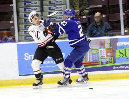 MISSISSAUGA - Owen Sound Attack defenceman Sean Durzi (left) jostles with the Mississauga Steelheads' Stefan Leblanc (right) during first period Ontario Hockey League aciton on Monday.
