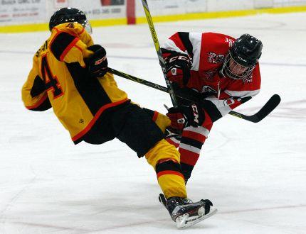 Brockville Tikis Noah Fraser knocks down Ottawa West Golden Knights Daniel Stratis in Wednesday's game.