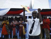 A boy celebrates the opening of Ngulot High School in Kenya's Masaai Mara in January.