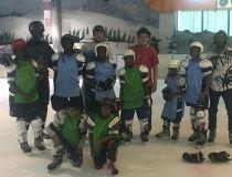 Three Leduc brothers donate hockey equipment to a team in Kenya.