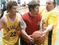 Tillsonburg Wildcats' Corey Mulholland is surrounded under the basket Saturday in the Wildcats Basketball Tournament at Glendale High School. (CHRIS ABBOTT/TILLSONBURG NEWS)
