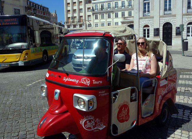 Little tuk-tuks are a fun way to sightsee around Lisbon. (photo: Rick Steves)