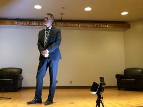 University of Toronto professor Jordan Peterson addresses the crowd at the public library Saturday.
