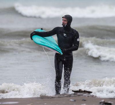 Hugh Whitaker in Lake Ontario at Ashbridges Bay. Whitaker was enjoying the blast of winter in Lake Ontario  on Tuesday March 14, 2017. Craig Robertson/Toronto Sun/Postmedia Network