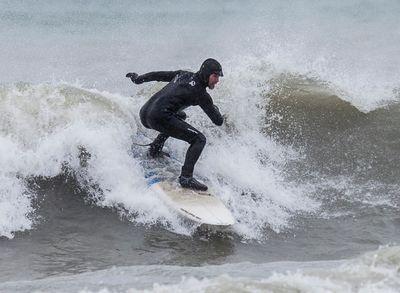 Matt Bujok surfing in Lake Ontario at Ashbridges Bay. Bujok was enjoying the blast of winter in Lake Ontario  on Tuesday March 14, 2017. Craig Robertson/Toronto Sun/Postmedia Network